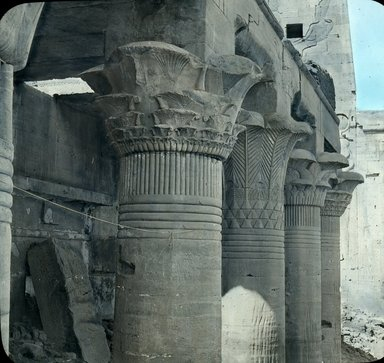 """<em>""""Views, Objects: Egypt. Philae. View 01: Egypt - Philae. Temple of Isis. Capitals of east colonnade.""""</em>. Lantern slide 3.25x4in, 3.25 x 4 in. Brooklyn Museum, lantern slides. (S10_08_Egypt_Philae01.jpg"""