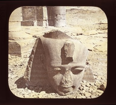 """<em>""""Views, Objects: Egypt. Thebes. View 04: Egypt - The Ramesseum, Head of Colossus of Ramses II, Thebes. 19 Dyn.""""</em>. Lantern slide 3.25x4in, 3.25 x 4 in. Brooklyn Museum, lantern slides. (Photo: T. H. McAllister, New York, S10_08_Egypt_Thebes04_SL1.jpg"""