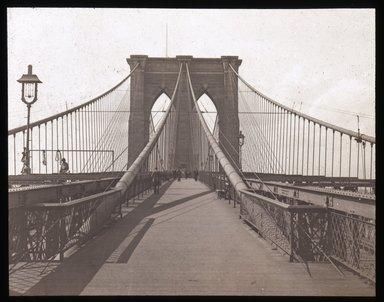 "<em>""Views: U.S., Brooklyn. Brooklyn Bridge. View 004: Brooklyn tower; from foot way.""</em>. Lantern slide 3.25x4in, 3.25 x 4 in. Brooklyn Museum, CHART_2011. (S10_21_US_Brooklyn_Brooklyn_Bridge004.jpg"