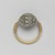 <em>Cowrie-Shaped Amulet in Gold Ring</em>, ca. 1630-1539 B.C.E. Steatite, glaze, gold, 9/16 x Diam. 15/16 in. (1.5 x 2.4 cm). Brooklyn Museum, Charles Edwin Wilbour Fund, 08.480.199. Creative Commons-BY (Photo: , 08.480.199_back_PS9.jpg)