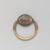 <em>Cowrie-Shaped Amulet in Gold Ring</em>, ca. 1630-1539 B.C.E. Steatite, glaze, gold, 9/16 x Diam. 15/16 in. (1.5 x 2.4 cm). Brooklyn Museum, Charles Edwin Wilbour Fund, 08.480.199. Creative Commons-BY (Photo: , 08.480.199_front_PS9.jpg)