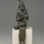 <em>Seated Statuette of Isis Holding Horus</em>, 332 B.C.E.-30 B.C.E. Bronze, 14 1/2 × 3 3/4 × 4 1/4 in. (36.8 × 9.5 × 10.8 cm). Brooklyn Museum, Museum Collection Fund, 11.682. Creative Commons-BY (Photo: Brooklyn Museum, 11.682_front_edited_PS2.jpg)