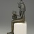 <em>Seated Statuette of Isis Holding Horus</em>, 332 B.C.E.-30 B.C.E. Bronze, 14 1/2 × 3 3/4 × 4 1/4 in. (36.8 × 9.5 × 10.8 cm). Brooklyn Museum, Museum Collection Fund, 11.682. Creative Commons-BY (Photo: Brooklyn Museum, 11.682_profile_left_edited_PS2.jpg)