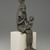 <em>Seated Statuette of Isis Holding Horus</em>, 332 B.C.E.-30 B.C.E. Bronze, 14 1/2 × 3 3/4 × 4 1/4 in. (36.8 × 9.5 × 10.8 cm). Brooklyn Museum, Museum Collection Fund, 11.682. Creative Commons-BY (Photo: Brooklyn Museum, 11.682_threequarter_right_edited_PS2.jpg)
