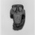 <em>Bes Amulet</em>, ca. 1836-1700 B.C.E. Faience, 1 1/4 x 13/16 x 3/8 in. (3.2 x 2.1 x 1 cm). Brooklyn Museum, Gift of Ariane, Nike, and Samara Mele, 1990.13. Creative Commons-BY (Photo: , 1990.13_print_bw_SL5.jpg)