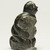 Elisapi Qumaluk (born 1927). <em>Kneeling Figure</em>, 1950-1980. Gray stone, 4 x 2 1/8 x 1 5/8 in. (10.2 x 5.4 x 4.1 cm). Brooklyn Museum, Hilda and Al Schein Collection, 2004.79.12. Creative Commons-BY (Photo: Brooklyn Museum, 2004.79.12_threequarter_right_PS11.jpg)