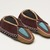 Delaware. <em>Youth Moccasins</em>, ca. 1900. Hide, cloth, beads, 4 1/4 × 1/8 × 7 3/8 in. (10.8 × 0.3 × 18.7 cm). Brooklyn Museum, Gift of the Edward J. Guarino Collection in memory of Edgar J. Guarino, 2016.11.3a-b. Creative Commons-BY (Photo: Brooklyn Museum, 2016.11.3a-b_view02_PS11.jpg)