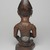 Yombe artist. <em>Figure of Mother and Child (Phemba)</em>, 19th century. Wood, glass, upholstery studs, metal, metal and glass buttons, resin, 11 x 5 x 4 1/2 in. (27.9 x 12.7 x 11.4 cm). Brooklyn Museum, Museum Expedition 1922, Robert B. Woodward Memorial Fund, 22.1138. Creative Commons-BY (Photo: , 22.1138_back_PS9.jpg)