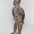 Kakongo artist. <em>Power Figure (Nkisi Nkondi)</em>, 19th century, with 20th century restoration. Wood, iron, glass, resin, kaolin, pigment, plant fiber, cloth, 33 7/8 x 13 3/4 x 11 in. (86 x 34.9 x 27.9 cm). Brooklyn Museum, Museum Expedition 1922, Robert B. Woodward Memorial Fund, 22.1421. Creative Commons-BY (Photo: , 22.1421_threequarter_left_PS9.jpg)