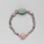 <em>Necklace with Uninscribed Scarab</em>, ca. 1938-1875 B.C.E. Amethyst, feldspar, Overall Diam. 2 3/16 in. (5.5 cm). Brooklyn Museum, Gift of the Egypt Exploration Society , 26.47. Creative Commons-BY (Photo: , 26.47_back_PS9.jpg)