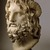 Roman. <em>Head of Serapis</em>, 75-150 C.E. Marble, 10 3/8 x 7 3/8 x 6 7/8 in. (26.4 x 18.7 x 17.5 cm). Brooklyn Museum, Charles Edwin Wilbour Fund, 37.1522E. Creative Commons-BY (Photo: Brooklyn Museum, 37.1522E_threequarter_left_SL1.jpg)
