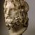 Roman. <em>Head of Serapis</em>, 75-150 C.E. Marble, 10 3/8 x 7 3/8 x 6 7/8 in. (26.4 x 18.7 x 17.5 cm). Brooklyn Museum, Charles Edwin Wilbour Fund, 37.1522E. Creative Commons-BY (Photo: Brooklyn Museum, 37.1522E_threequarter_left_SL1.jpg)
