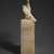 <em>Seated Statuette of Pepy I with Horus Falcon</em>, ca. 2338-2298 B.C.E. Egyptian alabaster, traces of Egyptian blue, red pigment, and gypsum, 10 1/2 x 2 3/4 x 6 1/4 in. (26.7 x 6.98 x 15.9 cm). Brooklyn Museum, Charles Edwin Wilbour Fund, 39.120. Creative Commons-BY (Photo: , 39.120_SL3.jpg)
