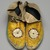 Sioux. <em>Pair of Moccasins</em>, ca. 1882. Hide, porcupine twill, 10 7/16 x 3 15/16 in. (26.5 x 10 cm). Brooklyn Museum, Anonymous gift in memory of Dr. Harlow Brooks, 43.201.66a-b. Creative Commons-BY (Photo: Brooklyn Museum, 43.201.66a-b_view1_PS2.jpg)