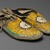 Sioux. <em>Pair of Moccasins</em>, ca. 1882. Hide, porcupine twill, 10 7/16 x 3 15/16 in. (26.5 x 10 cm). Brooklyn Museum, Anonymous gift in memory of Dr. Harlow Brooks, 43.201.66a-b. Creative Commons-BY (Photo: Brooklyn Museum, 43.201.66a-b_view2_PS2.jpg)