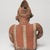 Nayarit. <em>Figurine of a Man</em>, 100 BCE - 200 CE. Ceramic, pigment, 9 1/2 x 6 1/2 x 5 1/2 in. (24.1 x 16.5 x 14 cm). Brooklyn Museum, Frank L. Babbott Fund, 47.186.1. Creative Commons-BY (Photo: Brooklyn Museum, 47.186.1_back_PS9.jpg)