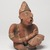 Nayarit. <em>Figurine of a Man</em>, 100 BCE - 200 CE. Ceramic, pigment, 9 1/2 x 6 1/2 x 5 1/2 in. (24.1 x 16.5 x 14 cm). Brooklyn Museum, Frank L. Babbott Fund, 47.186.1. Creative Commons-BY (Photo: Brooklyn Museum, 47.186.1_threequarter_right_PS9.jpg)