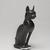 <em>Cat (Bastet)</em>, 664-343 B.C.E. Bronze, 5 1/4 x 1 5/8 x 3 3/4 in. (13.3 x 4.1 x 9.5 cm). Brooklyn Museum, Gift of Mrs. Nasli Heeramaneck, 78.243. Creative Commons-BY (Photo: , 78.243_threequarter_PS9.jpg)