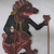 <em>Shadow Play Figure (Wayang kulit)</em>, before 1893. Leather, pigment, wood, fiber, 19 7/8 × 11 13/16 in. (50.5 × 30 cm). Brooklyn Museum, Brooklyn Museum Collection, 00.153. Creative Commons-BY (Photo: , CUR.00.153_overall.jpg)