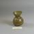 Roman. <em>Small Vase of Yellow Plain Blown Glass</em>, 1st-5th century C.E. Glass, 2 1/16 x Diam. 1 3/4 in. (5.2 x 4.4 cm). Brooklyn Museum, Gift of Robert B. Woodward, 01.177. Creative Commons-BY (Photo: Brooklyn Museum, CUR.01.177.jpg)