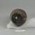 Roman. <em>Vase of Plain Blown Amethyst Glass</em>, 2nd century C.E. Glass, 3 7/16 x Diam. 2 13/16 in. (8.7 x 7.1 cm). Brooklyn Museum, Gift of Robert B. Woodward, 01.250. Creative Commons-BY (Photo: Brooklyn Museum, CUR.01.250_bottom.jpg)