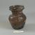 Roman. <em>Vase of Plain Blown Amethyst Glass</em>, 2nd century C.E. Glass, 3 7/16 x Diam. 2 13/16 in. (8.7 x 7.1 cm). Brooklyn Museum, Gift of Robert B. Woodward, 01.250. Creative Commons-BY (Photo: Brooklyn Museum, CUR.01.250_view1.jpg)