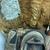 <em>Mask</em>. Wood, barkcloth, fiber, pigment, paste, tapestry turban snail (Turbo petholatus) opercula, 15 15/16 × 9 × 14 in. (40.5 × 22.9 × 35.6 cm). Brooklyn Museum, Brooklyn Museum Collection, 01.300. Creative Commons-BY (Photo: , CUR.01.300_detail04.jpg)