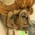 <em>Mask</em>. Wood, barkcloth, fiber, pigment, paste, tapestry turban snail (Turbo petholatus) opercula, 15 15/16 × 9 × 14 in. (40.5 × 22.9 × 35.6 cm). Brooklyn Museum, Brooklyn Museum Collection, 01.300. Creative Commons-BY (Photo: , CUR.01.300_side04.jpg)
