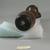 Roman. <em>Jug of Molded Amber Glass</em>, 4th-6th century C.E. Glass, 6 5/16 x diam. 2 3/8 in. (16 x 6.1 cm) . Brooklyn Museum, Gift of Robert B. Woodward, 01.367. Creative Commons-BY (Photo: Brooklyn Museum, CUR.01.367_bottom.jpg)