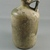 Roman. <em>Bottle of Plain Blown Glass</em>, 1st-5th century C.E. Glass, 7 1/16 x greatest diam. 3 3/4 in. (18 x 9.5 cm). Brooklyn Museum, Gift of Robert B. Woodward, 01.396. Creative Commons-BY (Photo: , CUR.01.396_view2.jpg)