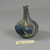 Roman. <em>Bottle of Blown Glass</em>, 3rd-4th century C.E. Glass, 2 5/8 x Diam. 2 in. (6.6 x 5.1 cm). Brooklyn Museum, Gift of Robert B. Woodward, 01.52. Creative Commons-BY (Photo: Brooklyn Museum, CUR.01.52_view1.jpg)