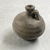 <em>Jar</em>. Clay, slip, 2 7/16 × Diam. 2 5/16 in. (6.2 × 5.8 cm). Brooklyn Museum, Gift of the Egypt Exploration Society, 02.219. Creative Commons-BY (Photo: , CUR.02.219_view02.jpg)