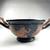 Greek. <em>Red-Figure Skyphos or Kotyle</em>, ca. 400 B.C.E. Clay, slip, 3 9/16 × 5 1/16 × 7 1/2 in. (9 × 12.8 × 19 cm). Brooklyn Museum, Gift of Robert B. Woodward, 03.284. Creative Commons-BY (Photo: Brooklyn Museum, CUR.03.284_view01.jpg)