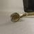 Roman. <em>Trumpet</em>, 4th-5th century C.E. Glass, 3 11/16 x 1 3/4 x 8 9/16 in. (9.3 x 4.4 x 21.7 cm). Brooklyn Museum, Gift of R. B. Woodward, 05.35. Creative Commons-BY (Photo: Brooklyn Museum, CUR.05.35_detail2.jpg)