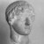 Roman. <em>Head, Apollo of the Omphalos</em>, 1st century C.E. copy of a 480 B.C.E. original. Marble, 12 11/16 x 7 5/8 in. (32.3 x 19.3 cm). Brooklyn Museum, Purchased with funds given by A. Augustus Healy and Robert B. Woodward Memorial Fund, 18.166. Creative Commons-BY (Photo: Brooklyn Museum, CUR.18.166_NegH_print_bw.jpg)