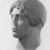Roman. <em>Head, Apollo of the Omphalos</em>, 1st century C.E. copy of a 480 B.C.E. original. Marble, 12 11/16 x 7 5/8 in. (32.3 x 19.3 cm). Brooklyn Museum, Purchased with funds given by A. Augustus Healy and Robert B. Woodward Memorial Fund, 18.166. Creative Commons-BY (Photo: Brooklyn Museum, CUR.18.166_NegO_print_bw.jpg)