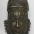 Edo. <em>Pendant Mask (Uhunmwun-ekue)</em>, 19th century. Copper alloy, iron, 7 3/4 × 4 5/16 × 1 3/4 in. (19.7 × 11 × 4.5 cm). Brooklyn Museum, Gift of Dorothy Robbins, 1993.180.15. Creative Commons-BY (Photo: , CUR.1993.180.15_front.jpg)