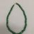 Maya. <em>Necklace</em>, 300-600. Jade beads (prehispanic), metal chain and clasp (modern), 3/8 × 3/8 × 16 in. (1 × 1 × 40.6 cm). Brooklyn Museum, Bequest of Mrs. Carl L. Selden, 1996.116.4. Creative Commons-BY (Photo: , CUR.1996.116.4.jpg)
