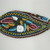 Iroquois. <em>Glengarry Cap</em>, ca. 1870. Cloth, beads, ribbon, 5 3/8 × 3 9/16 × 10 7/8 in. (13.7 × 9 × 27.6 cm). Brooklyn Museum, Gift of the Edward J. Guarino Collection in memory of Edgar J. Guarino, 2016.11.14. Creative Commons-BY (Photo: , CUR.2016.11.14_view01.jpg)