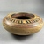 Greek. <em>Circular Pot</em>, 575-550 B.C.E. Clay, slip, 2 3/16 x Diam. of body 6 3/16 in. (5.5 x 15.7 cm). Brooklyn Museum, Gift of Mrs. Frederic H. Betts, 22.19. Creative Commons-BY (Photo: Brooklyn Museum, CUR.22.19_view04.jpg)