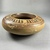 Greek. <em>Circular Pot</em>, 575-550 B.C.E. Clay, slip, 2 3/16 x Diam. of body 6 3/16 in. (5.5 x 15.7 cm). Brooklyn Museum, Gift of Mrs. Frederic H. Betts, 22.19. Creative Commons-BY (Photo: Brooklyn Museum, CUR.22.19_view05.jpg)