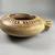Greek. <em>Circular Pot</em>, 575-550 B.C.E. Clay, slip, 2 3/16 x Diam. of body 6 3/16 in. (5.5 x 15.7 cm). Brooklyn Museum, Gift of Mrs. Frederic H. Betts, 22.19. Creative Commons-BY (Photo: Brooklyn Museum, CUR.22.19_view06.jpg)