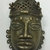 Edo. <em>Pendant Mask (Uhunmwun-ekue)</em>, 19th century. Copper alloy, 4 15/16 × 2 15/16 in. (12.5 × 7.5 cm). Brooklyn Museum, Museum Expedition 1923, Purchased with funds given by Frederic B. Pratt and Frank L. Babbott, 23.280. Creative Commons-BY (Photo: , CUR.23.280_front.jpg)