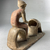 Greek. <em>Statue of a Woman Baking</em>, 5th century B.C.E. Terracotta, pigment, 4 1/2 × 2 1/8 × 2 9/16 in. (11.4 × 5.4 × 6.5 cm). Brooklyn Museum, Charles Edwin Wilbour Fund, 34.697. Creative Commons-BY (Photo: Brooklyn Museum, CUR.34.697_view07.jpeg)