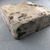 <em>Mold for Making Benu Bird</em>, 305-30 B.C.E. Limestone, 5 1/16 × 4 13/16 × 1 5/8 in. (12.8 × 12.3 × 4.2 cm). Brooklyn Museum, Charles Edwin Wilbour Fund, 37.1536E. Creative Commons-BY (Photo: , CUR.37.1536E_view04.jpg)