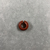 <em>Penannular Earring</em>. Red jasper, Diam. 3/16 × 9/16 in. (0.5 × 1.4 cm). Brooklyn Museum, Charles Edwin Wilbour Fund, 37.1964E. Creative Commons-BY (Photo: , CUR.37.1964E_view01.jpg)