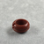 <em>Penannular Earring</em>, ca. 1539-1190 B.C.E. Red jasper, Diam. 1/4 × 1/2 in. (0.6 × 1.2 cm). Brooklyn Museum, Charles Edwin Wilbour Fund, 37.1970E. Creative Commons-BY (Photo: , CUR.37.1970E_view03.jpg)