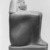 <em>Overseer of Weavers, Min</em>, ca. 1479-1425 B.C.E. Green siltstone or greywacke, 9 1/4 × 4 1/2 × 6 in., 14 lb. (23.5 × 11.4 × 15.2 cm, 6.35kg). Brooklyn Museum, Charles Edwin Wilbour Fund, 37.249E. Creative Commons-BY (Photo: , CUR.37.249E_NegID_L160_56_print_bw.jpg)