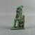 <em>Enthroned Bast Figure</em>, ca. 945-656 B.C.E. Faience, 2 5/8 x 7/8 x 1 9/16 in. (6.7 x 2.3 x 4 cm). Brooklyn Museum, Charles Edwin Wilbour Fund, 37.974E. Creative Commons-BY (Photo: Brooklyn Museum, CUR.37.974E_left01.jpg)