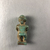 <em>Amulet of Pataikos</em>, 664-332 B.C.E. Faience, 1 15/16 × 7/8 × 11/16 in. (5 × 2.3 × 1.8 cm). Brooklyn Museum, Charles Edwin Wilbour Fund, 37.986E. Creative Commons-BY (Photo: , CUR.37.986E_view03.jpg)
